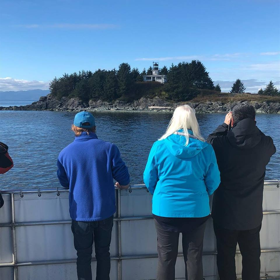 Lighthouse Excursions in Ketchikan shares Guard Island with passengers looking out onto the water